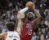 Portland Trail Blazers' Aleksandar Pavlovic (L) defends as Miami Heat's LeBron James shoots in the first half of their NBA basketball game in Miami, Florida February 12, 2013. REUTERS/Andrew Innerarity
