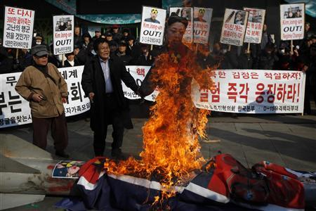 An activist from an anti-North Korea civic group burns an effigy of North Korea's leader Kim Jong-un, its flag and a mock North Korean missile during a rally against North Korea's nuclear test near the U.S. embassy in central Seoul February 13, 2013. REUTERS/Kim Hong-Ji