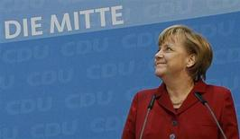 German Chancellor Angela Merkel looks up as she arrives together with Lower Saxony federal state premier David McAllister to a news conference following a board meeting of Merkel's Christian Democratic Union party CDU in Berlin January 21, 2013. REUTERS/Wolfgang Rattay
