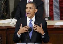 Dans son discours sur l'état de l'Union, Barack Obama s'est présenté comme le défenseur d'une classe moyenne frappée par les difficultés économiques malgré les profits des entreprises. /Photo prise le 12 février 2013/REUTERS/Kevin Lamarque