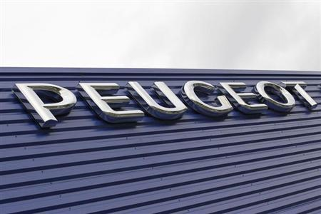 The word Peugeot is displayed on the front of a car dealership in Bordeaux, Southwestern France, February 12, 2013. REUTERS/Regis Duvignau