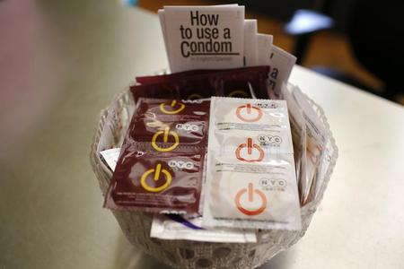 A bowl of free New York City condoms are seen in a lobby at the AIDS Service Center of New York City (ASC/NYC) lower Manhattan headquarters July 3, 2012. REUTERS/Mike Segar