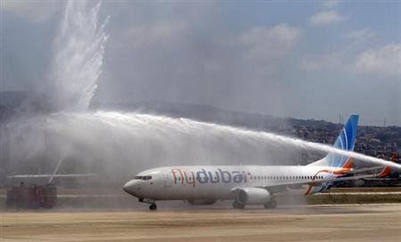 Flydubai, the first passenger flight of Dubai's first low cost carrier, is sprayed with water to celebrate its first landing in Beirut international airport June 1, 2009. REUTERS/Sharif Karim