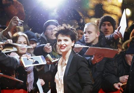Fans react as actress Juliette Binoche arrives at the red carpet for the screening of the movie ''Camille Claudel 1915'' at the 63rd Berlinale International Film Festival in Berlin February 12, 2013. REUTERS/Fabrizio Bensch