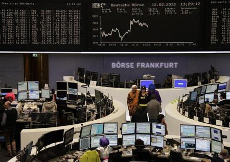 Traders in carnival costumes pose for pictures in front of the DAX board at the Frankfurt stock exchange February 12, 2013. REUTERS/Remote/Janine Eggert (GERMANY - Tags: BUSINESS) - RTR3DOHZ