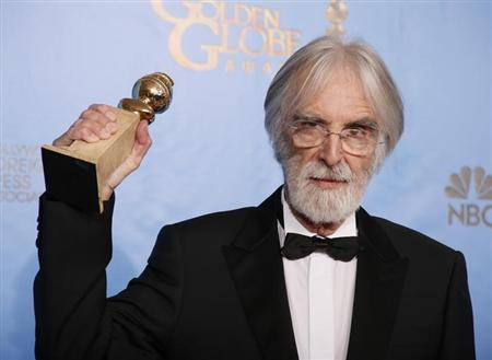 Director Michael Haneke holds his award for Best Foreign Language Film for ''Amour'' backstage at the 70th annual Golden Globe Awards in Beverly Hills, California, January 13, 2013. REUTERS/Lucy Nicholson/Files