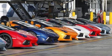 Lamborghini LP 700-4 Roadsters are displayed after a high-speed demonstration to mark the automaker's 50th anniversary at Miami International Airport January 28, 2013. REUTERS/Robert Sullivan