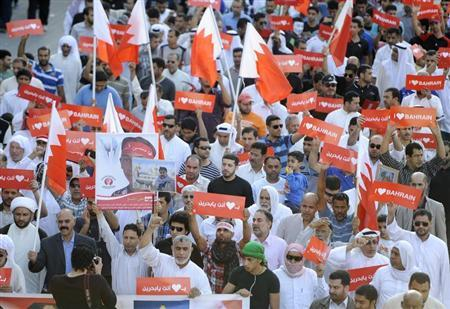Anti-government protesters with banners reading, ''I Love Bahrain'' march during a rally organized by the main opposition Wefaq on the streets of Sitra, south of Manama February 10, 2013. REUTERS/Stringer