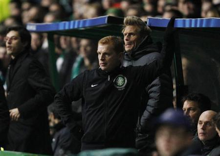 Celtic manager Neil Lennon watches the play from the dugout during their Champions League soccer match against Juventus at Celtic Park stadium in Glasgow, Scotland February 12, 2013. REUTERS/David Moir