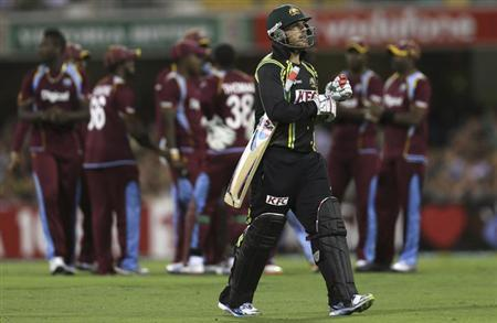 Australia's Aaron Finch leaves the ground after his dismissal against West Indies during their Twenty20 international cricket match at the Gabba in Brisbane February 13, 2013. REUTERS/Aman Sharma