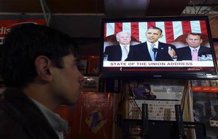 An Afghan man watches a television broadcast of U.S. President Barack Obama delivering his State of the Union speech, in Kabul February 13, 2013. Obama on Tuesday outlined plans to withdraw 34,000 of the 66,000 U.S. troops in Afghanistan over the next year and called anew for action on immigration reform at home. REUTERS/Omar Sobhani (AFGHANISTAN - Tags: POLITICS MILITARY) - RTR3DPZ8