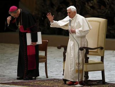 Pope Benedict XVI blesses at the end of his Wednesday general audience in Paul VI hall at the Vatican February 13, 2013. REUTERS/Stefano Rellandini