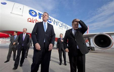 File photo showing Chief Executive Officers of carriers that are part of the Oneworld airline alliancein front of a passenger jet during a ceremony marking Airberlin's accession to the network at the BBI airport outside of Berlin, March 20, 2012. REUTERS/Thomas Peter