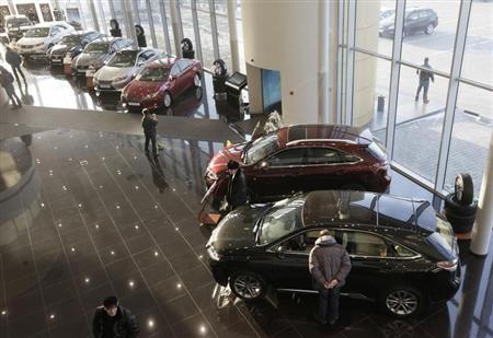 People visit a Lexus cars sales and show room in Krasnoyarsk, February 6, 2013. REUTERS/Ilya Naymushin