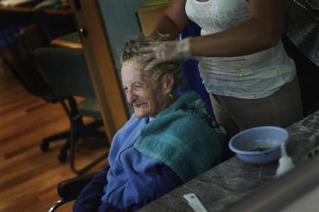 An Alzheimer's patient has her hair done inside the Alzheimer foundation in Mexico City April 19, 2012. REUTERS/Edgard Garrido
