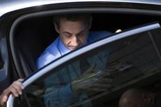 """Alain Juppé a dit mercredi qu'il croyait """"sentir"""" chez Nicolas Sarkozy, dont il a été le ministre des Affaires étrangères, une envie de se présenter à l'élection présidentielle de 2017. /Photo d'archives/REUTERS/Lionel Bonaventure/Pool"""