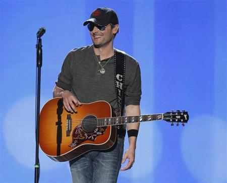 Singer Eric Church smiles after performing ''Springsteen'' at the 47th annual Academy of Country Music Awards in Las Vegas, Nevada, April 1, 2012. REUTERS/Steve Marcus/Files