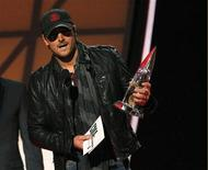 "Eric Church accepts the award for album of the year for ""Chief"" at the 46th Country Music Association Awards in Nashville, Tennessee, in this file photo taken November 1, 2012. REUTERS/Harrison McClary"