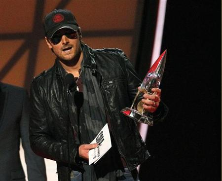 Eric Church accepts the award for album of the year for ''Chief'' at the 46th Country Music Association Awards in Nashville, Tennessee, in this file photo taken November 1, 2012. REUTERS/Harrison McClary