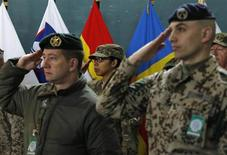 NATO troops salute during a change of command ceremony in Kabul February 10, 2013. U.S. Marine General Joseph Dunford, expected to oversee the withdrawal of most foreign troops from Afghanistan by the end of next year, took control of the NATO-led mission on Sunday, in an elaborate ceremony which emphasised the country's sovereignty. REUTERS/Omar Sobhani (AFGHANISTAN - Tags: MILITARY POLITICS)