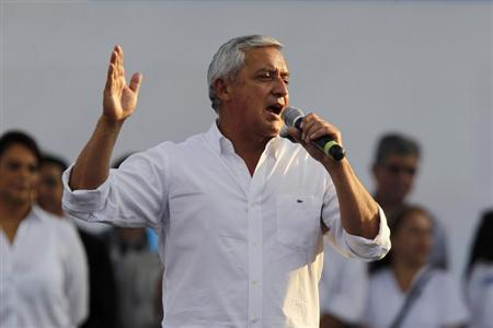Guatemalan President Otto Perez Molina speaks during an event to commemorate the first anniversary of his government, in Colonia La Alameda, in the Zona 18, Guatemala City January 13, 2013. REUTERS/Jorge Dan Lopez