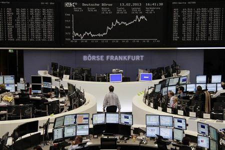 Traders are pictured at their desks in front of the DAX board at the Frankfurt stock exchange February 13, 2013. REUTERS/Remote/Janine Eggert (GERMANY - Tags: BUSINESS)