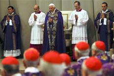 Pope Benedict XVI attends Ash Wednesday mass at the Vatican February 13, 2013. Thousands of people are expected to gather in the Vatican for Pope Benedict's Ash Wednesday mass, which is expected to be his last before leaving office at the end of February. REUTERS/Alessandro Bianchi