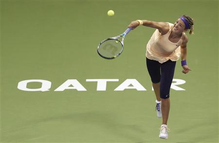 Victoria Azarenka of Belarus serves the ball to Romina Oprandi of Switzerland during their women's match at the Qatar Open tennis tournament in Doha February 13, 2013. REUTERS/Fadi Al-Assaad