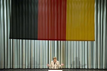 File photo of German Chancellor Angela Merkel delivering a speech at a conference of the leadership of the German armed forces, the Bundeswehr, in Strausberg near Berlin, October 22, 2012. REUTERS/Thomas Peter/Files