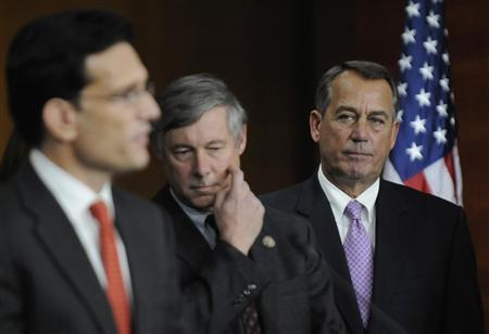 U.S. House Speaker John Boehner (R-OH) (R) listens to Rep. Eric Cantor (R-VA) (L) during a news conference at the U.S. Capitol in Washington, December 22, 2011. REUTERS/Jonathan Ernst