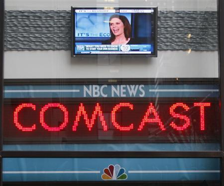 The news ticker outside the Today Show announces GE's sale of NBC to Comcast, in New York, in this December 3, 2009 file photo. REUTERS/Chip East/Files