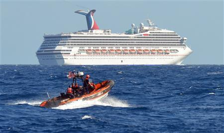 A small boat from the U.S. Coast Guard Cutter Vigorous patrols near the cruise ship Carnival Triumph in the Gulf of Mexico, in this February 11, 2013 handout photo. REUTERS/U.S. Coast Guard/Lt. Cmdr. Paul McConnell/Handout