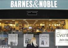 A woman looks in from a window panel of a Barnes and Noble store in New York October 24, 2012. REUTERS/Brendan McDermid