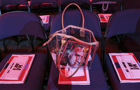A purse containing Time magazine in Tampa, Florida August 28, 2012. REUTERS/Eric Thayer