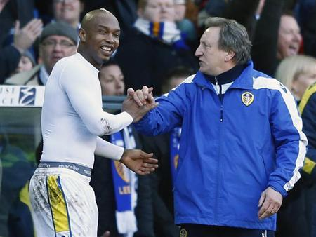 Leeds United's El-Hadji Diouf (L) celebrates with manager Neil Warnock after beating Tottenham Hotspur in their FA Cup fourth round soccer match at Elland Road in Leeds, northern England, January 27, 2013. REUTERS/Darren Staples