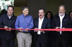Mexican businessman Carlos Slim (R), Microsoft founder and philanthropist Bill Gates (2nd L), Governor of the State of Mexico Eruviel Avila (L) and Mexican agriculture minister Enrique Martinez (2nd R) cut the ribbon during the inauguration of a new research facility at the International Maize and Wheat Improvement Center (CIMMYT) in Texcoco outside Mexico City February 13, 2013. REUTERS/Henry Romero