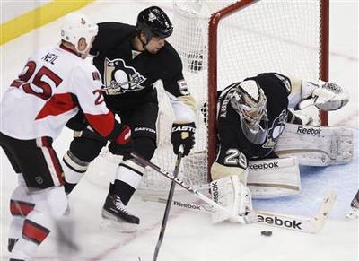 Senators lose to Penguins, lose Karlsson to injury