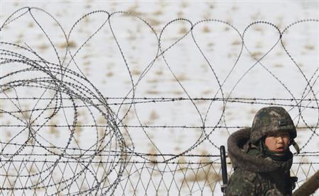 A South Korean soldier patrols near the demilitarized zone separating South Korea from North Korea, in Paju, north of Seoul February 13, 2013. REUTERS/Lee Jae-Won