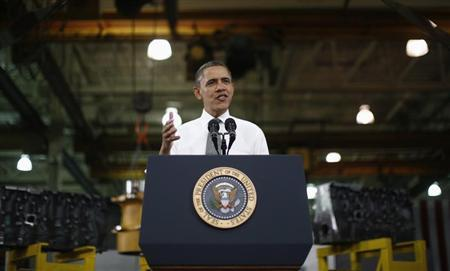 U.S. President Barack Obama delivers remarks on the economy after touring Linamar Corporation that manufactures parts for the truck industry in Arden, North Carolina, February 13, 2013. REUTERS/Jason Reed