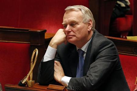 France's Prime Minister Jean-Marc Ayrault attends the vote on the same-sex marriage bill at the National Assembly in Paris February 12, 2013. France's lower house of parliament backed same-sex marriage in a vote on Tuesday, paving the way for it to enter law after street marches rallied hundreds of thousands of demonstrators both for and against it. REUTERS/Charles Platiau (FRANCE - Tags: POLITICS SOCIETY)