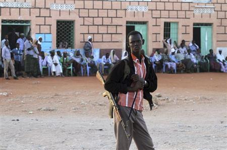 A fighter from the moderate Ahlu Sunna forces stands on guard, as security is tightened during a public gathering in the area of Dhusamareeb in central Somalia December 14, 2012. Picture taken December 14, 2012. REUTERS/Feisal Omar
