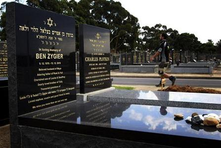 A workman walks through a Jewish cemetery, past the grave of Ben Zygier (L), the Australian which local media have identified as the man who died in an Israeli prison in 2010 and who may have been recruited by Israeli intelligence agency Mossad, in Melbourne February 14, 2013. REUTERS/Brandon Malone