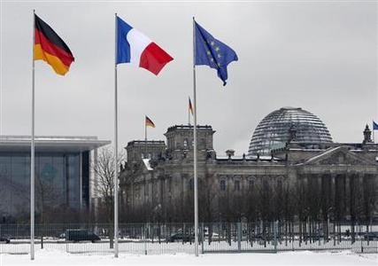 A German, French and an EU flag flutter over the German lower house of parliament in Berlin January 22, 2013, during a day of celebrations marking the 50th Anniversary of the Elysee Treaty. REUTERS/Fabrizio Bensch