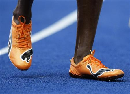 Usain Bolt of Jamaica sports new running shoes after the ninth men's 100 metres heats during the world athletics championships at the Olympic stadium in Berlin, August 15, 2009. REUTERS/Michael Dalder (GERMANY) - RTR26Q7G