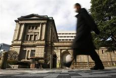 "A man walks past in front of the Bank of Japan in Tokyo February 14, 2013. Bank of Japan Governor Masaaki Shirakawa said on Thursday that the central bank's monetary policy is not directly targeting currency moves. ""The BOJ is conducting monetary policy to achieve stability in Japan's economy. It will continue to do so and I will explain this to the G20 nations,"" Shirakawa told a news conference ahead of a gathering of G20 finance leaders in Moscow over the weekend. Picture is taken in slow shutter REUTERS/Yuya Shino (JAPAN - Tags: BUSINESS) - RTR3DROR"