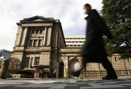 A man walks past in front of the Bank of Japan in Tokyo February 14, 2013. Bank of Japan Governor Masaaki Shirakawa said on Thursday that the central bank's monetary policy is not directly targeting currency moves. ''The BOJ is conducting monetary policy to achieve stability in Japan's economy. It will continue to do so and I will explain this to the G20 nations,'' Shirakawa told a news conference ahead of a gathering of G20 finance leaders in Moscow over the weekend. Picture is taken in slow shutter REUTERS/Yuya Shino (JAPAN - Tags: BUSINESS) - RTR3DROR