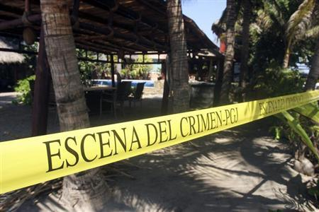 A yellow police line reading ''Crime Scene'' cordons off a crime scene at a beach hotel, where six female Spanish tourists were raped by armed men, in Acapulco February 6, 2013. REUTERS/Jacobo Garcia