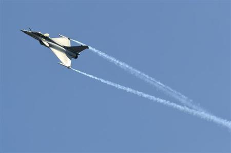 A Dassault Rafale combat aircraft, which has been selected by the Indian Air Force for purchase, performs during the inauguration ceremony of the 'Aero India 2013' at Yelahanka air force station on the outskirts of Bangalore February 6, 2013. REUTERS/Stringer