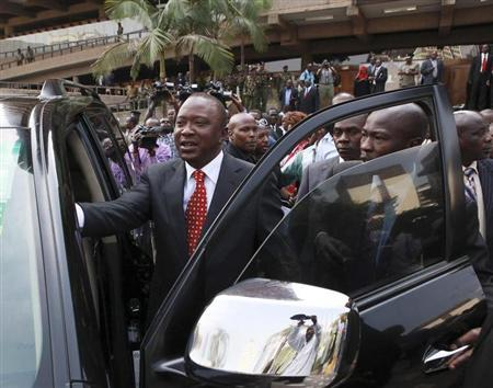 Kenya's Deputy Prime Minister Uhuru Kenyatta leaves in company of supporters after he was cleared by the Independent Electoral and Boundaries Commission (IEBC) to run for presidency in the March 4 presidential elections, in capital Nairobi January 30, 2013. REUTERS/Noor Khamis