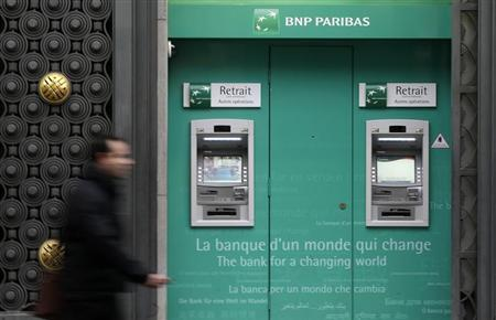 A man walks past an automatic teller outside a BNP Paribas bank in central Paris October 26, 2012. REUTERS/Jacky Naegelen